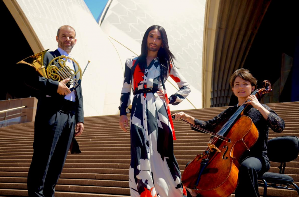 Conchita Wurst, who has been in Australia the past few days for Adelaide's Feast Festival, will return to Australia once again early 2016 as part of the Sydney Gay and Lesbian Mardi Gras festival line-up. Pictured here with members of the Sydney Symphony Orchestra, with whom she'll share the stage for a one-off concert night in March. (PHOTO: David Alexander; Star Observer)