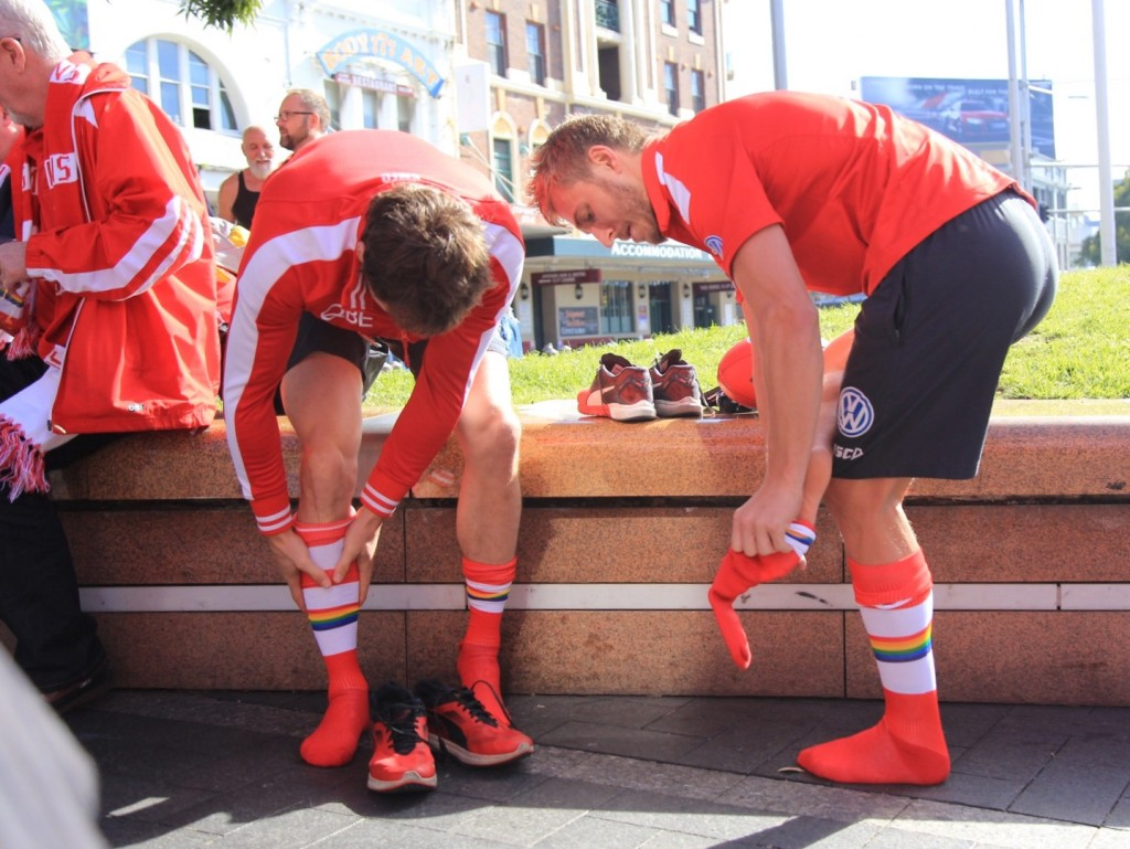 Sydney Swans players Nick Smith (L) and Kieren Jack get into their rainbow socks ahead of the AFL's first Pride Game on Saturday