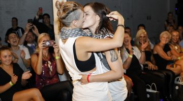 The couple embrace at the aGenda fashion show after the proposal. Picture: Ann-Marie Calilhanna